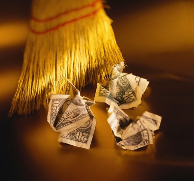 Sweeping Crumpled Dollar Bills with a Broom